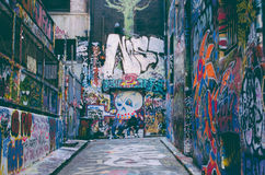 Street With Paintings on the Wall during Daytime Royalty Free Stock Photography