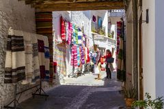 Street of Pampaneira full of handicrafts royalty free stock photography