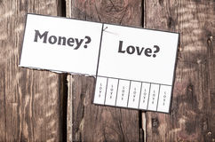 Street paper note, advertisment with tear-off stripes. Love versus money concept Royalty Free Stock Photos