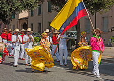 Street parade of colombian dancers. Street parade of ensemble Jocaycu from Colombia with national flag - colombian dancers in traditional dress performs popular Stock Photos