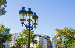 Street of Paris with buildings summertime. Street of Paris with buildings and trees summertime Stock Image