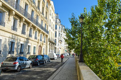 Street of Paris with buildings summertime. Street of Paris with buildings and trees summertime Stock Photos