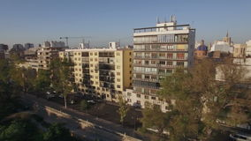 Street with park and traffic in Valencia, aerial view stock video footage