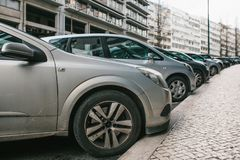Street parking with cars in Lisbon, Portugal. Cars parked on street. Penalties for parking and payment for car parking Royalty Free Stock Images