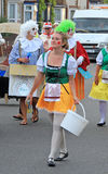 Street party toy people. Photo of a street party carnival girl walking through town of whitstable kent Royalty Free Stock Photography