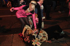 Street party at Zombie Crawl and Parade 2015, Toronto, Ontario, Canada. Couple in costume partying on the street during the Zombie Crawl and Parade 2015 in royalty free stock photos
