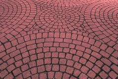 Street patterns geometric pink red. Geometric shape of a street made of cement bricks. In Quebec, Canada Royalty Free Stock Images