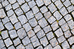 Street paved with cobblestone Stock Images