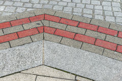 Street pavement pattern with grey and pink stones Royalty Free Stock Image