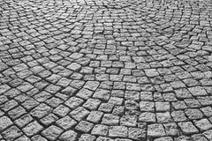 Street paving stone in black and white. Urban sidewalk. Street paving stone in black and white. Antique urban sidewalk Royalty Free Stock Photography