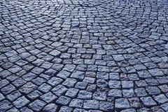 Street paving stone in blue tone. Antique urban sidewalk. Horizontal Stock Photography
