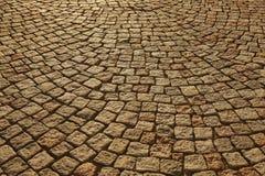 Street paving stone in warm tone. Antique urban sidewalk. Horizontal Stock Image