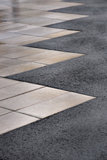 Street paving stones. Background of street paving stones and asphalt Royalty Free Stock Image