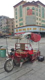 Street peddle on motorvehicle Royalty Free Stock Image