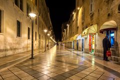 A street without people. Marmont street in Split. The most popular pedestrians strrets is almost empty during late fall at night time. Just few locals walking Royalty Free Stock Photos