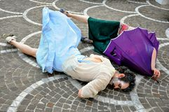 Street performance in Italy. Street theatre in Pontedera,  Italy . two young actrors  play a scene on the streets of a small town . street art concept Royalty Free Stock Photography