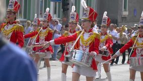 Ternopil, Ukraine June 27, 2019: Street performance on the occasion of the holiday. Young girls drummer in red at the. Street performance on the occasion of the stock video