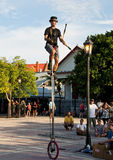 Street performer. An artist performing at the Sunset Celebration at Mallory Square Dock in Key West, Florida. Each night around two hours before sunset masses of Stock Photography