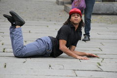 Street performer acting out on sidewalk,Faneuil Hall,Boston,Mass,2014 Royalty Free Stock Image