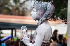 Street Performer as Capricorn or Goat man with glass ball on Purim holiday royalty free stock photography