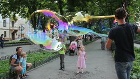 Street Performer Blows Bubbles stock video footage