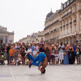 Street performer breakdancing in front of the random crowd. Royalty Free Stock Photos