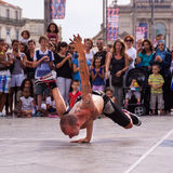 Street performer breakdancing in front of the random crowd. Stock Photography