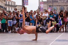 Street performer breakdancing in front of the random crowd. Royalty Free Stock Photography