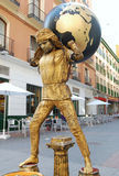 Street performer (busker) in Spain with globe Royalty Free Stock Photos