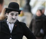 Street Performer / Charlie Chaplin. Street performer imitates famous  commedian Charlie Chaplin. Picture taken in London, near London Eye Royalty Free Stock Photos