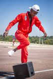 Street performer dancing with beer crate. Johannesburg, South Africa, 29th March - 2019: Street dancer performing at traffic intersection with beer crate. The stock images