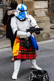 Street performer disguised as a kilted Star Wars stormtrooper Royalty Free Stock Images