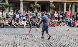 Street performer engages audience outside Covent Garden Stock Photography
