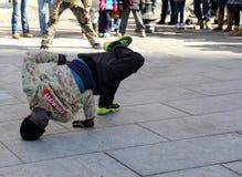 Street performer entertaining crowd,Boston,2014. Male street performer busy entertaining the crowd gathered around to watch the show,Boston,March 1st,2014 Stock Photo