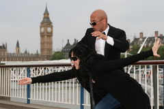 Street Performer / Frozen Moment. Street performer does freeze frame action scenes. Picture taken in London, near London Eye, on the River Thames south bank, Big stock photo
