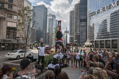 Street performer. A group of young dancer performs infront of the crowd Royalty Free Stock Photography