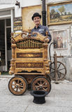 Street performer and his old music box Royalty Free Stock Photography