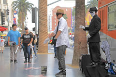 Street performer. HOLLYWOOD,CA - Nov 1, 2015: Street performer for tips on the world famous walk of fame on Hollywood blvd in Hollywood, CA Royalty Free Stock Images