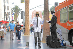 Street performer. HOLLYWOOD,CA - Nov 1, 2015: Street performer for tips on the world famous walk of fame on Hollywood blvd in Hollywood, CA Stock Images