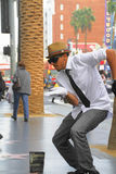 Street performer. HOLLYWOOD,CA - Nov 1, 2015: Street performer for tips on the world famous walk of fame on Hollywood blvd in Hollywood, CA Royalty Free Stock Photo