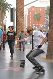 Street performer. HOLLYWOOD,CA - Nov 1, 2015: Street performer for tips on the world famous walk of fame on Hollywood blvd in Hollywood, CA Stock Photos