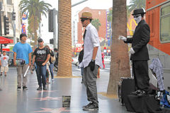 Street performer. HOLLYWOOD,CA - Nov 1, 2015: Street performer for tips on the world famous walk of fame on Hollywood blvd in Hollywood, CA Stock Photo