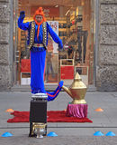 Street performer in image of genie Stock Image