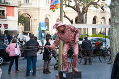 Street Performer imitating bronze statue Stock Photography