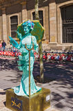 Street performer imitating statue at La Ramblas in Barcelona, Sp Royalty Free Stock Photo