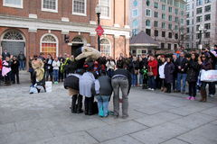 Street performer jumping over bystanders,Boston Royalty Free Stock Photos