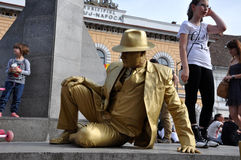 Street performer, living statue in golden costume Stock Photography