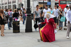 Street Performer London England. Street performer impersonating Queen Elizabeth II on the streets of London in Piccadilly Circus Stock Photography