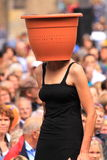 Street performer with plant pot on head Stock Photography