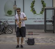 Street Performer Playing The Saxophone Royalty Free Stock Images